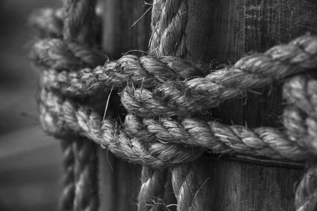 rope knotted around a post